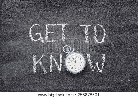 Get To Know Phrase Written On Chalkboard With Vintage Stopwatch Used Instead Of O