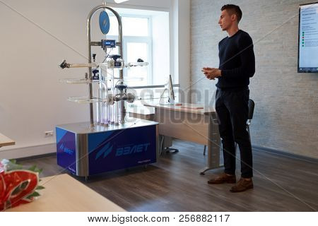 ST. PETERSBURG, RUSSIA - SEPTEMBER 1, 2018: Teacher demonstrates various water flow meters for freshmen of Water Academy in the day of starting the first academic year for full time students