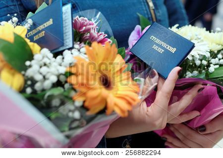 ST. PETERSBURG, RUSSIA - SEPTEMBER 1, 2018: Freshmen with student cards and flowers during the ceremony of start of academic year in Water Academy. The Academy was founded in 2015