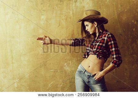 Nonverbal Communication, Gunfighter. Pretty Girl Or Sexy Woman With Blond, Long Hair In Stylish Cowb