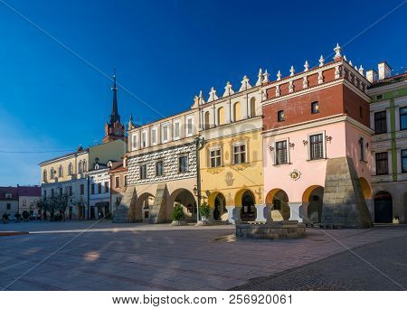 Scenic view of renaissance tenement houses on market square of old town in Tarnow, Poland poster