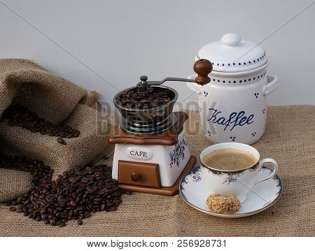 Close Up With Coffee Grinder, Cup With Coffee, Porcelain Coffee Tin, Coffee Sack With Coffee Beans