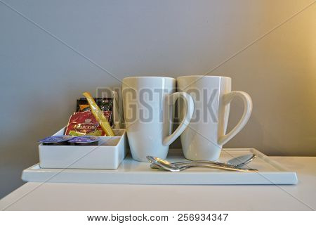 MOSCOW, RUSSIA - CIRCA AUGUST, 2018: two white cups in a hotel room in Holiday Inn Express. Holiday Inn Express is a mid-priced hotel chain within the InterContinental Hotels Group family of brands.