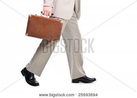 Walking man holding an old suitcase isolated over white background