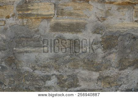 Gray Brown Stone Texture Of Plaster And Kipiches On The Old Wall