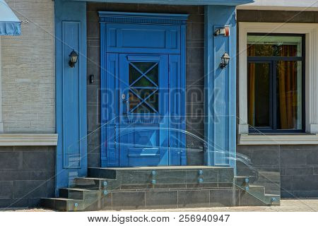 Blue Wooden Door And Threshold On The Wall Of A Building With A Window