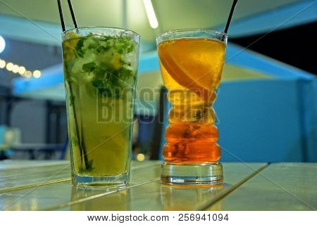 Mojito And Cocktail In Two Long Glass Glasses On The Table