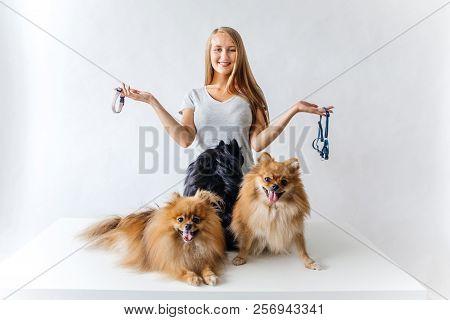 Portrait Of A Woman Choosing A Leash For A Dog