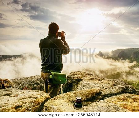 Photographer Looks Into Fall Landscape Through Camera Viewfinder. Man Prepare Camera To Takes Impres