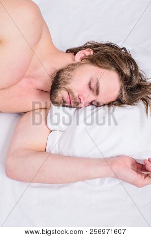 Pleasant Awakening Concept. Man Unshaven Handsome Guy Naked Torso Relaxing Bed Top View. Guy Sexy Ma