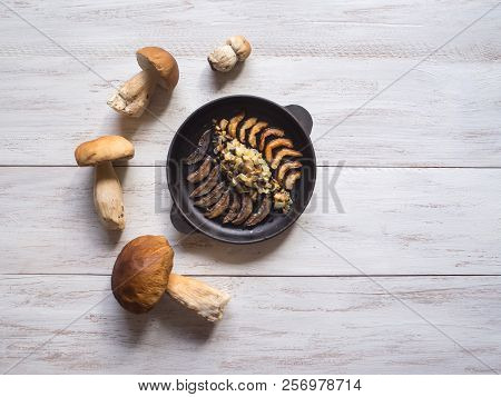 Cooking Penny Bun. Fried Cepes In A Iron Pan On The White Wooden Table. Top View