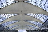 metallic and glass roof structure poster
