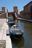 Perspective of Trepponti bridge. Comacchio. Emilia-Romagna. Italy. poster