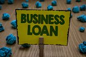 Text sign showing Business Loan. Conceptual photo Credit Mortgage Financial Assistance Cash Advances Debt Clothespin holding yellow paper note crumpled papers several tries mistakes. poster
