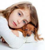 brunette kid girl with mini pinscher pet mascot dog on white background poster