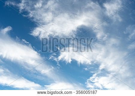 Cirrus Is Cloud Stripe, White, Feathery, Ice Crystal. Blue Background Of The Sky