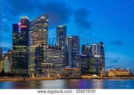 Singapore - February 16 2020: Singapore Cityscape Financial building  in Marina Bay area Singapore at  Dusk