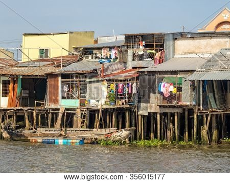 Can Tho, Vietnam - February 3, 2016: Shacks On Stilts Along The Hau River In The Mekong Delta