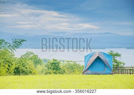 Camping Trip Tent On Holiday. Adventures Camping Tourism And Tent.  Beautiful Lake With Tent In Plac