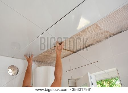 Pvc Ceiling Panels, Cladding Installation. Builder Installing, Renovate, Repair White Pvc Ceiling Bo