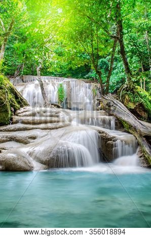 Deep Forest Waterfall At Erawan Waterfall, Beautiful Waterfall With Sunlight Rays In Deep Forest, Er