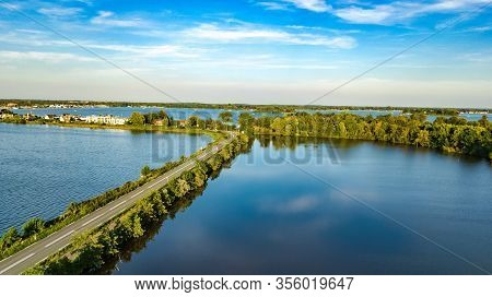 Aerial Drone View Of Motorway Road And Cycling Path On Polder Dam, Cars Traffic From Above, North Ho