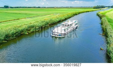 Aerial Drone View Of Houseboat In Canal And Country Landscape Of Holland From Above, Family Travel B