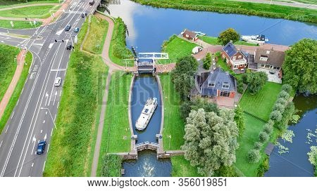 Aerial Drone View Of Houseboat In Canal Lock, Landscape Of Holland From Above, Family Travel By Barg