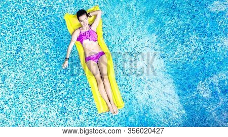 Beautiful Young Woman In Hat In Swimming Pool Aerial Top View From Above, Young Girl In Bikini Relax