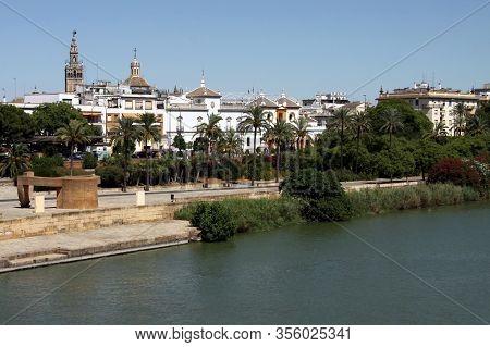 Seville, Spain - July 14, 2011:embankment Of The River Guadalquivir In Seville