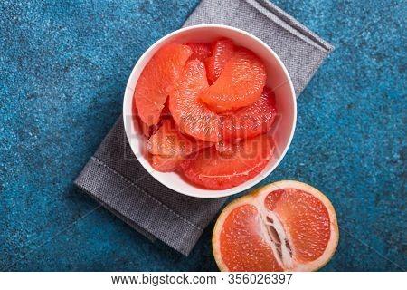 Grapefruit. Fresh Grapefruit Slices In A Wooden Bowl, Healthy Snack. Fresh Grapefruit Slices