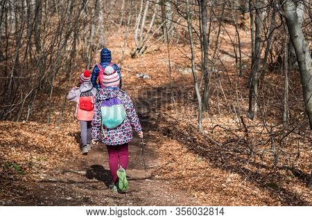 Portrait Of Family On Hiking Forest Trip With Hiking Clothes.