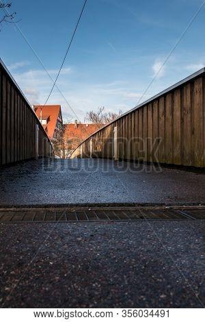 Little Pedestrian Bridge Across The River With Blue Sky