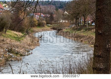 Little River Through The Green Countryside Along The Village