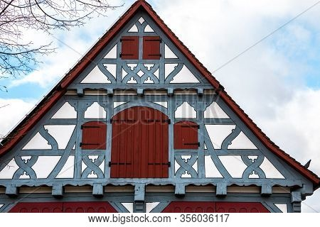 Old Historical Building With Blue Wooden Beams And Red Windows And Red Doors