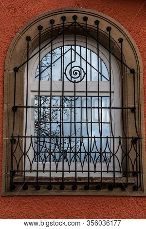 Window Of A Historical Building With Iron Grid