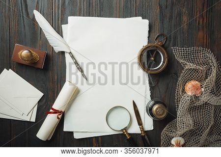 Old Fashioned Flat Lay With Letters Writing Accessories On Dark Wooden Background. White Sheets, Pen
