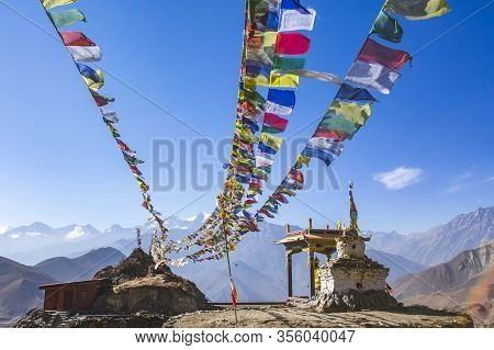 Gompa And Multicolored Buddhist Flags In Muktinatn, Nepal