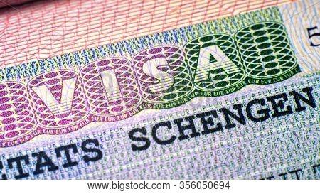 Visa Stamp In Passport Closeup. European Visitor Visa At Border Control. Macro View Of Schengen Visa