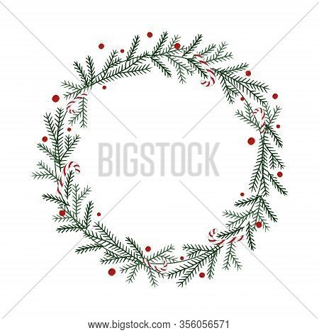 Spruce Wreath Wreath Decorated With Christmas Candies And Dainty Berries. Perfect For Christmas And