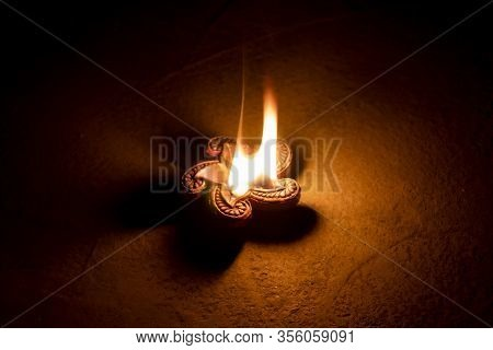Glowing Clay Lamp In Dark Night On The Floor - Happy Diwali, Light Festival, Illuminated Lights