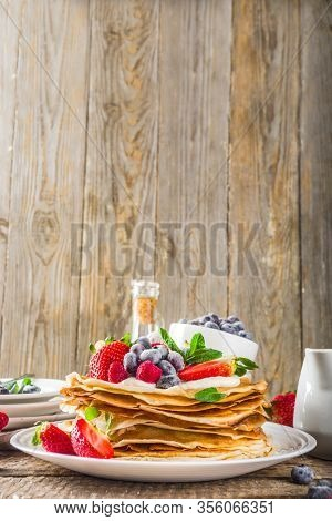 Sweet French And Russian Style Homemade Pancake Crepes. Layered Crepe Cake With Whipped Cream Or Mas