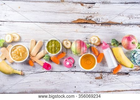 Infant Baby Food. Bowls With Vegetable Fruit Puree, Green, Orange, Yellow Colors - Broccoli, Carrots