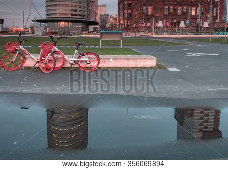 Rotterdam, The Netherlands - 12 February 2019: Hotel New York, Two Red Bicycles Parked In Front Of T