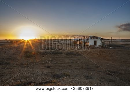 Australian Outback Abandoned Derelict House With Sunset Flare And Copy Space In Marree, South Austra