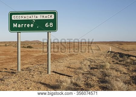 Marree Oodnadatta Track Signage Selective Focus, With Bullet Holes In Sign Metal, Located Roadside O