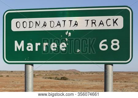 Marree Oodnadatta Track Signage Close Up And Selective Focus, With Bullet Holes In Sign Metal, Locat