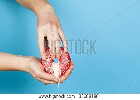 Female Hands And A Donut On A Blue Background As A Symbol Of Masturbation And Foreplay (prelude) Bef