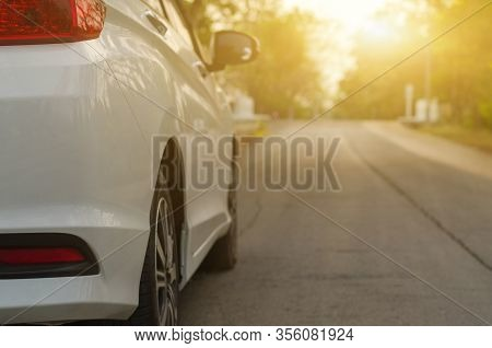 White Car Parking On The Street With Sunset Background