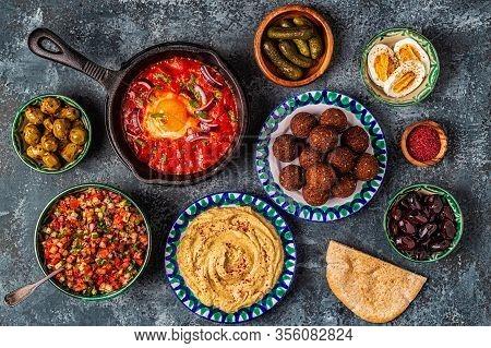 Falafel, Hummus, Shakshuka, Israeli Salad - Traditional Dishes Of Israeli Cuisine.